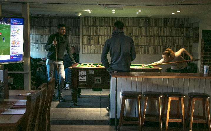 Pool table and players